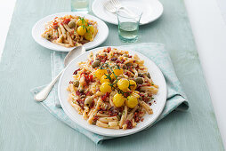 Casarecce with yellow tomatoes, olives, capers and dried tomatoes