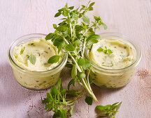 Homemade basil butter in preserving jars