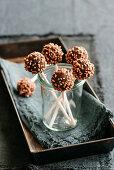 Gianduia orange lollies with sesame seeds