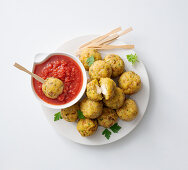 Fried cheese and bread bites with a spicy tomato sauce