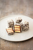 Lamingtons (sponge cake with raspberry jelly, chocolate and coconut flakes, Australia)