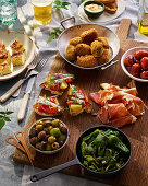 Tapas Selection With Tortilla, Chorizo, Serrano Ham, Croquets, Peppers and Olives