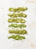 Green tea powder on a white background