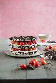 Small cherry meringue cake with dark chocolate
