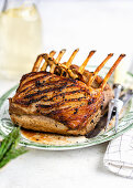 Roasted rack of lamb on a platter