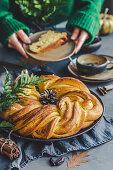 Autumn yeast cinnamon-pumpkin cake in a fancy wreath shape, coffee in the background
