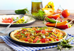 Pizza peperonata with pepperoni, peppers, tomatoes and rosemary