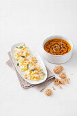 Farfalle with sage butter and pumpkin cream soup, served with amaretti brittle