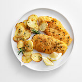 Breaded chicken escalope with fried potatoes