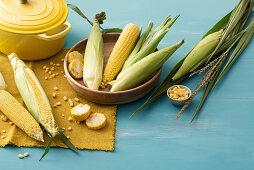 An arrangement of corn with a yellow pot