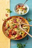Quinoa salad with grilled corn, avocado, cured ham and chilli