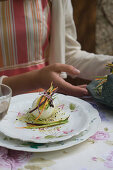 Woman eating egg stuffed with bottarga on sprouts with julienne vegetables