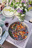 Blueberry tagliolini with mushrooms and cherry tomatoes