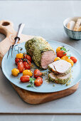 In herb and cheese crusted veal loin with toast tomatoes