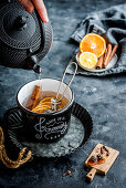 Mulled tea with oranges, cloves, cinnamon and Siberian cones