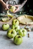 Preparing apple pie, peeling apples, cake in a mold