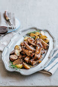 Pork ribs in honey-pepper marinade with grilled potatoes