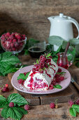 Raspberry meringue roll with cream