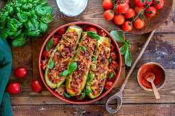 Stuffed zucchinis with meat and tomato filling