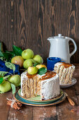 Vertical apple cake with cinnamon and cream