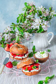 Bagels with cream cheese and strawberries