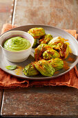 Zucchini flowers with turmeric and potato filling and zucchini and peppermint sauce