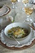 Corzetti con salsa di pinoli e maggiorana (Parmesan pasta with pine nut and marjoram sauce, Italy)