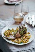 Rack of lamb with pistachio and herb crust and fried potatoes