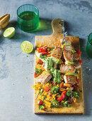 Tuna skewers with corn salad and avocado dressing