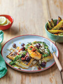 Mediterranean fish and chips with calamata olives