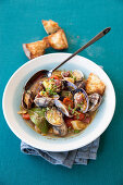 Clam soup with smoked peppers