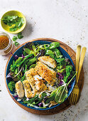 Coconut-crusted chicken schnitzel salad