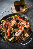 Paella with fish, seafood and ribs