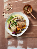 Braised coconut chicken with peanuts and vegetables