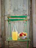 Naturally cloudy apple juice in a glass carafe
