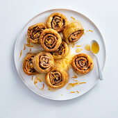 Fried chestnut and chocolate snails with orange-honey sauce