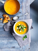 Carrot soup with feta and quinoa