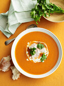 Tomato and coconut soup with chicken