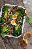 Salad with smoked mackerel, apple, eggs and lime dressing