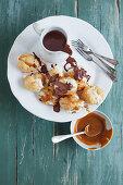 Mini profiteroles with caramel sauce