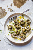 Hemp seed tortellini with lemony spinach and ricotta