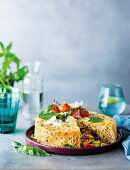 Giant spaghetti timbale with seafood filling