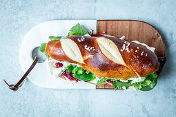 Lye bread stick with brie and cranberries