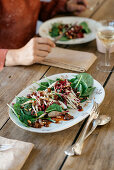 Spinach salad with caramelised shallots, port wine raisins and roasted pine nuts
