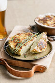 Potato bake with piave cheese and herbs