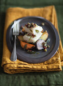 Slow-cooked cod on a bed of olive oil and rosemary potatoes