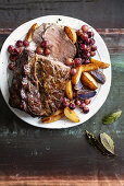 Roast beef with grapes and potatoes