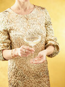 A woman holding a glass of champagne
