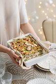 Lasagne verdi with ham, mushrooms, cheese and breadcrumbs