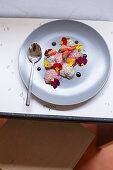 Vegan dessert plate with vanilla-strawberry-basil-chia pudding, balsamic cream and edible flowers